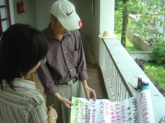 Checking the poster with the calligrapher