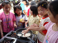 Kids making chapatis on Happy Stacking Day